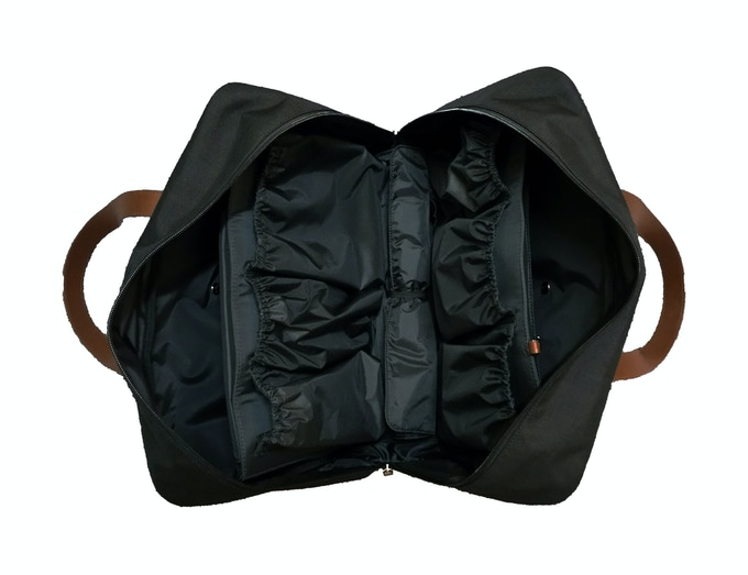 The All Around Zipper Allows The Smart Pockets Diaper Bag to Lay Flat for Easy Packing