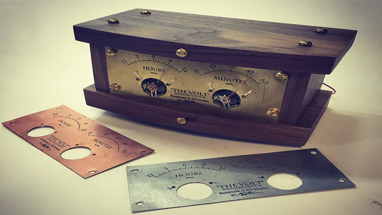 """""""The Volt"""" is an open source, hackable, analog clock. Built by hand in exotic hardwoods, brass, steel, and copper. 4 Models + DIY"""