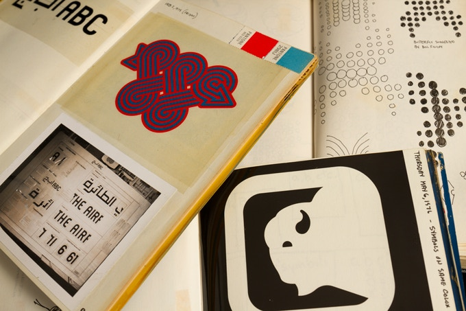 Pages from Lance Wyman's original 'designlogs' showing sketches, Polaroid, print and colour swatches