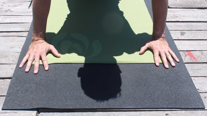 Regular Yoga Mats (green) are too small.  Yeoman Gear mats are a head-length longer and a hand's width wider.