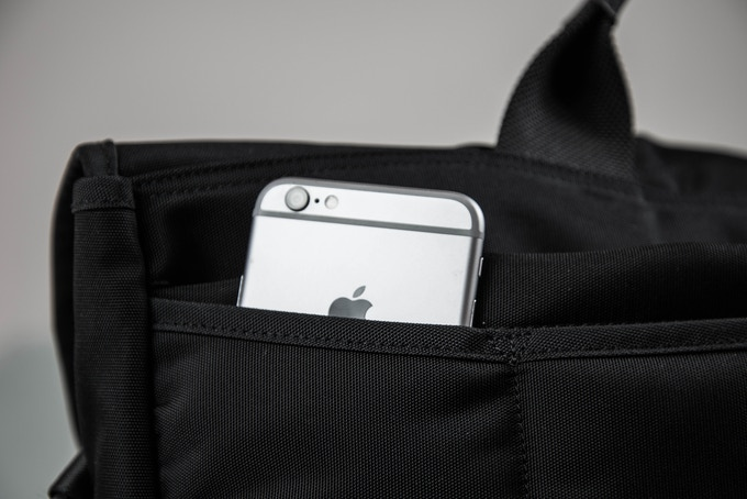 Dedicated hidden external phone pocket for easy phone storage