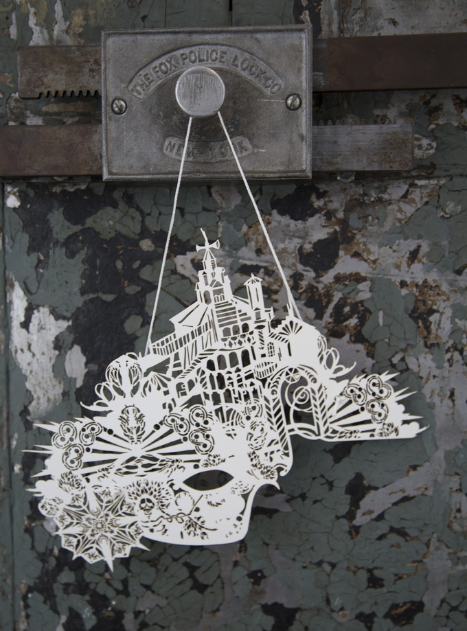 One of Swoon's new Music Box-inspired Carnival masks, available only through this campaign
