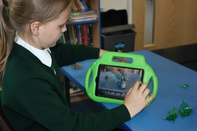 Child animating with an iPad/tablet