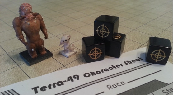 prototype miniatures with dice & character sheet