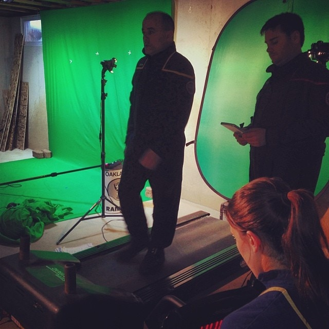 "A DIY treadmill and green screen setup in Tommy's basement to simulate walking in a scene for ""Horizon."""
