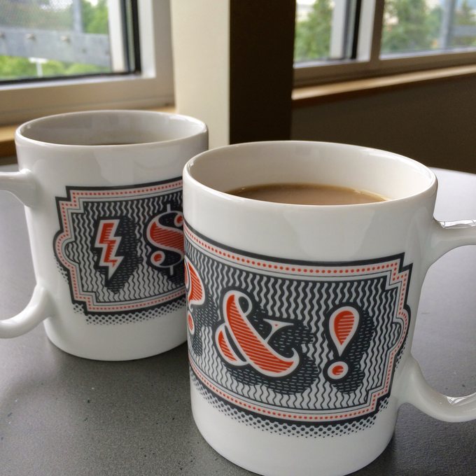 Museum-quality porcelain mugs with in-glaze graphic.