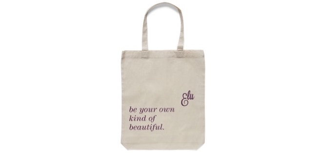 TOTE BAG - Carry on with grace and curvy style with a convenient tote from Elu. Perfect for office extras and gym shoes.