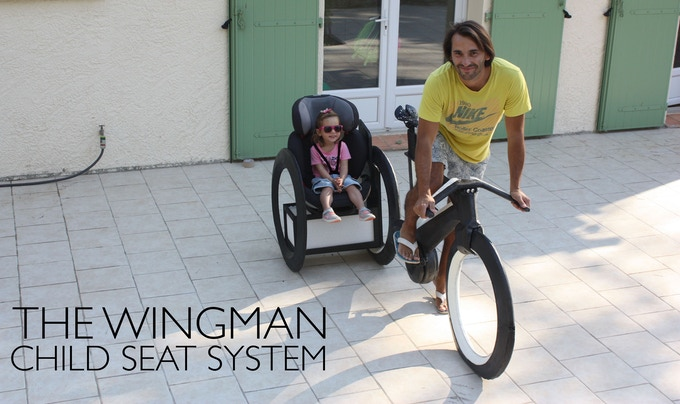 Ride with your kids: Safely secured, within sight & reach at any time.