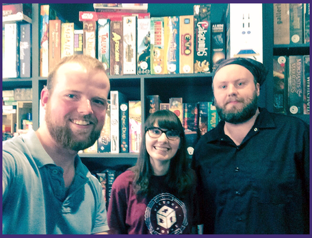 Victory Point Cafe is a great example of a board game cafe located in Berkeley, CA - featured in this picture are two of their engaging game gurus with Pawns and Pints' Edward Schmalz