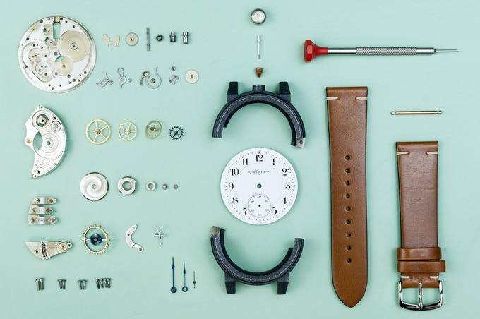 A fully disassembled watch movement