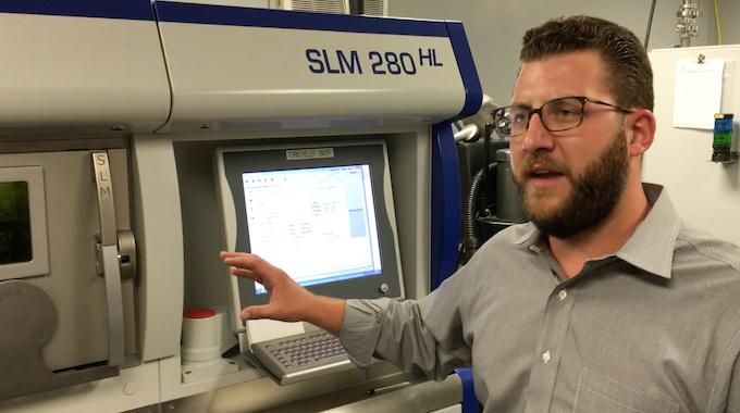 Christian Joest explaining his metal 3D printer