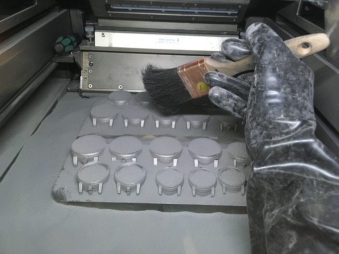 Removing titanium powder after printing