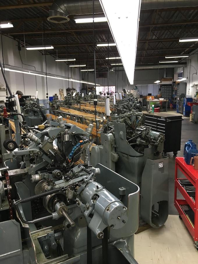 Cam driven Swiss turning machine floor