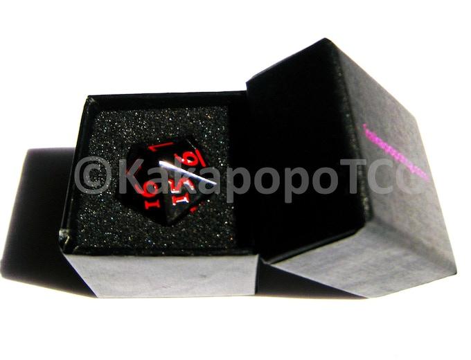 Prototype Black Dice in Prototype Packaging