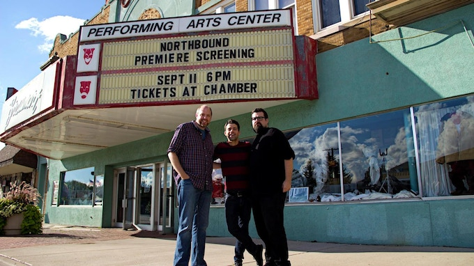 Jason Hagen, Seth and Nathan Anderson stand outside of Iron Mountain's historic Braumart Theater, where Season 1 of Northbound screened to a sold-out crowd in late 2015.