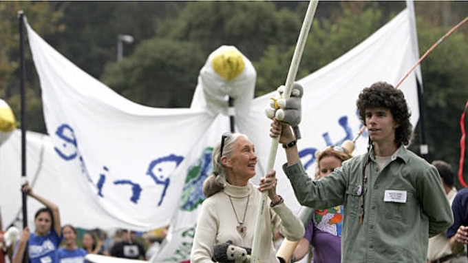 Washo Shadowhawk and Jane Goodall leading a parade of giant dove puppets (2006, LA Times)