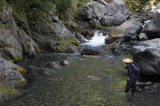 Mr. Sebata fishing a mountain stream in Japan during one of Daniel's visits