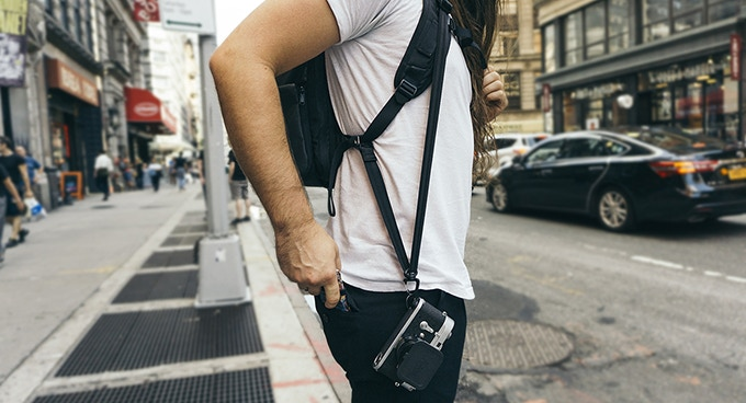 Our integrated camera sling keeps your camera right at your fingertips. With all of the weight off your neck, it's much more comfortable than a neck strap.