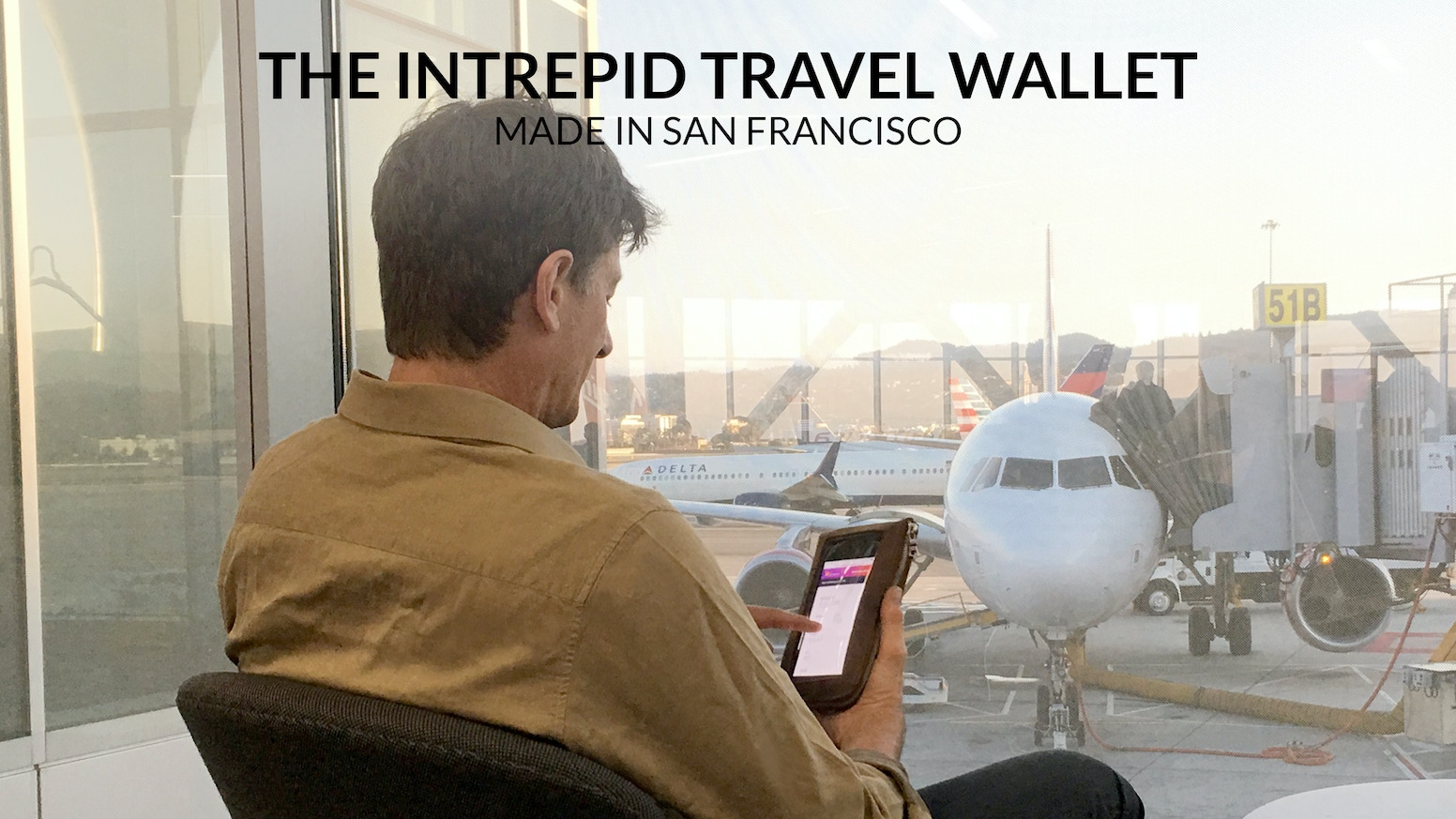 A WaterField (SFbags) play-through RFID-blocking travel wallet and iPhone case. Holds phone, passport, cash, credit cards, & more.