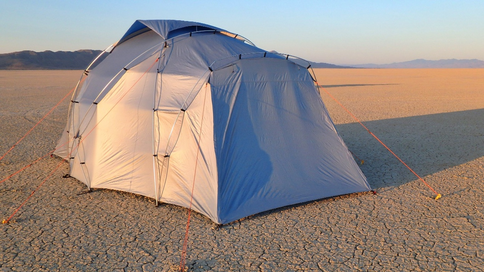 Don't bake in your tent! Stay cool and sleep in. Patent pending, heat reflective, light blocking, and  designed for wind & dust.