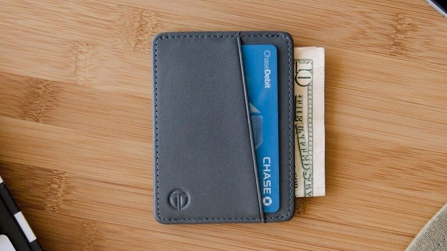 Slim minimalist wallet with push through cash slot for easy access and functionally designed card slots for everyday use.