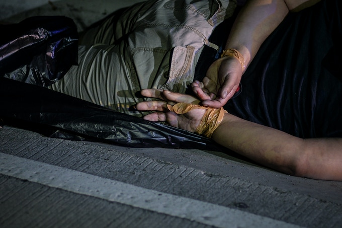 The corpse of a suspected drug addict and victim of a vigilante-style execution with his hands tied with tape lie on a street in Pasay, south of Manila, Philippines. This is one of images available as a print.