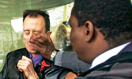 Robert Mugabe's security attack British human rights activist Peter Tatchell after he attempted a citizens' arrest of the Zimbabwean president in Brussels on 5 March 2001