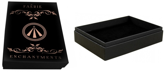 The presentation gift box featuring gilt rose gold design