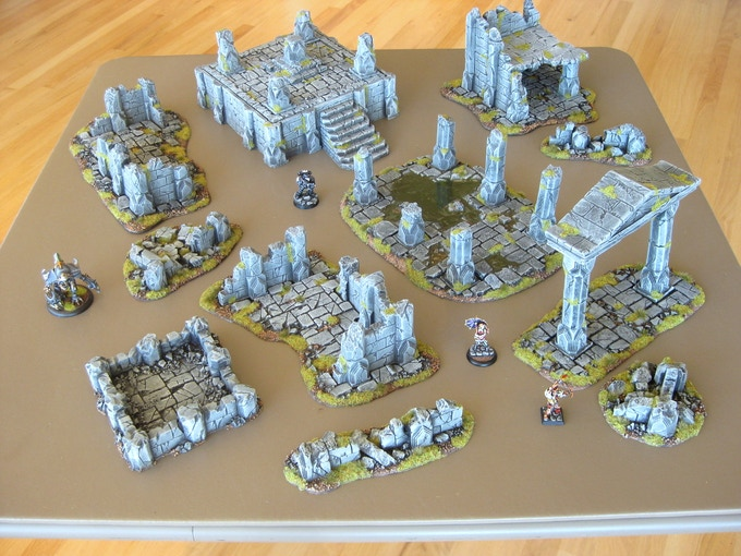 The Complete Set pledge level laid out on a 3' x 3' table with miniatures for size reference.