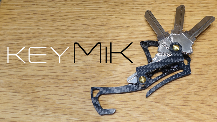 A robust EDC key organizer designed for secure, comfortable, one-handed operation.  Precision CNC milled from carbon fiber in Canada.