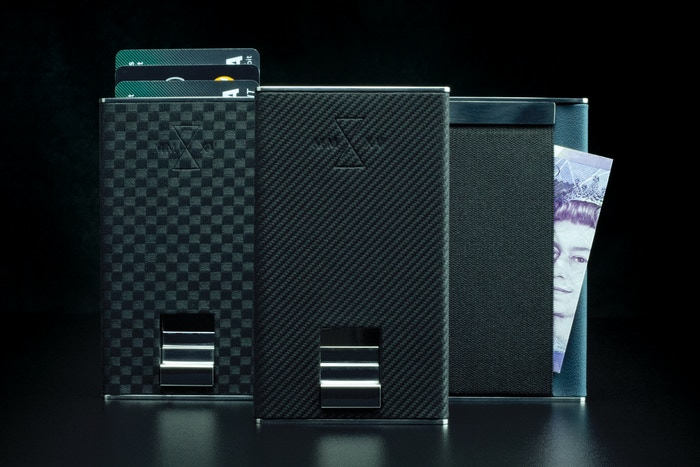 Carbon fibre infused leather. Metal construction. Handmade wallets for the modern minimalist.