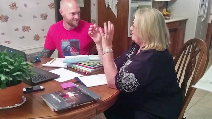 Mon and her Boy working on their book