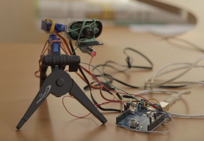"Petcube: ""For the Petcube Camera, created an Arduino-based prototype on a tripod mount, assembled with a laser pointer and rubber bands. Petcube Play is the next-gen version."""
