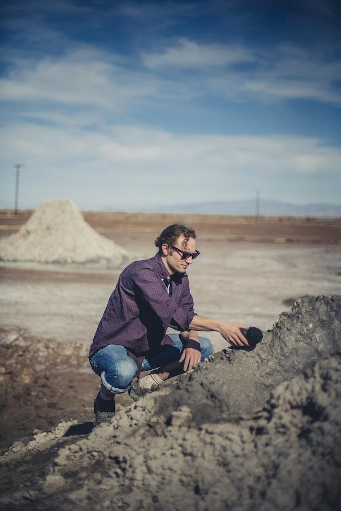 Sam interviewing a mud pot - Photo by Gundi Vigfusson