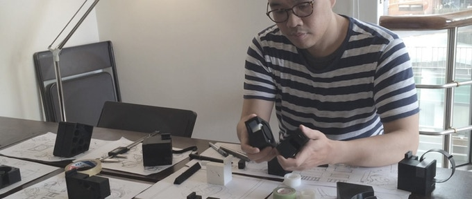 Our product designer, Nigel, with his sketches and prototypes.