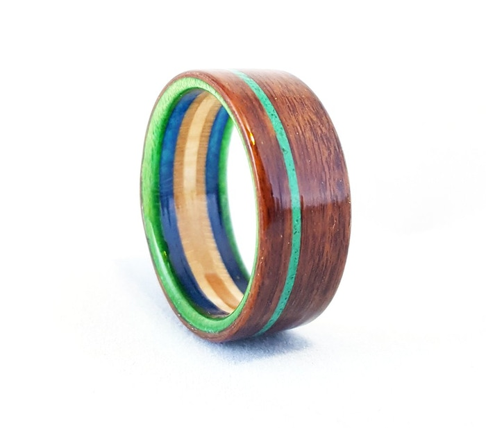 Custom handmade rings created using the bentwood method and a Recycled  skateboard liner. Every ring 1ec8dbbec99