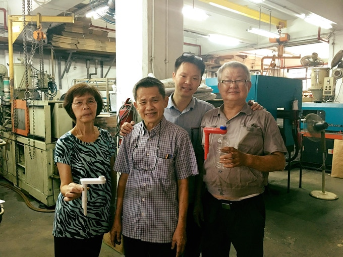 The Loh Family. Mrs Loh checks every GIY Stick that comes off the production line.
