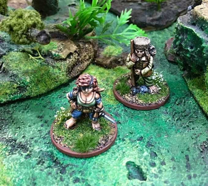 Rugged Halfling adventurers scouting the path