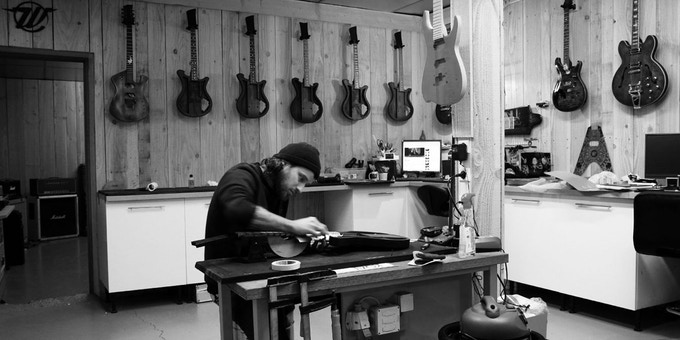 WildCustomGuitars master builder Ju in the workshop