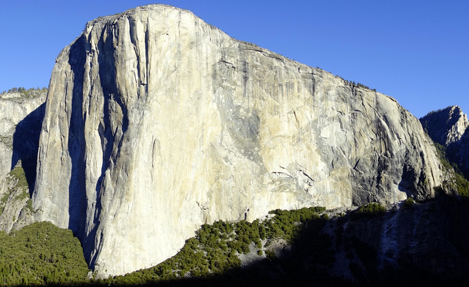 El Capitan - about 3,000 vertical foot rise at it's tallest point. Often considered to be the largest single piece of granite in the world