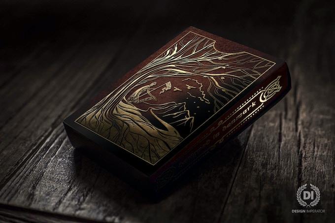 Yggdrasil tuck case w. artwork in golden, embossed foil.