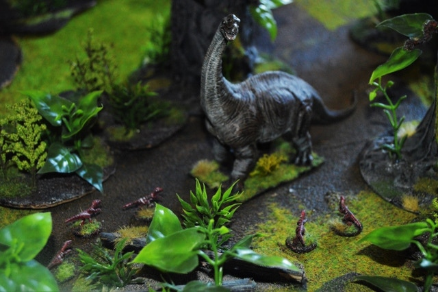 An argentinosaurus defends its home ground against a troop of raptors!