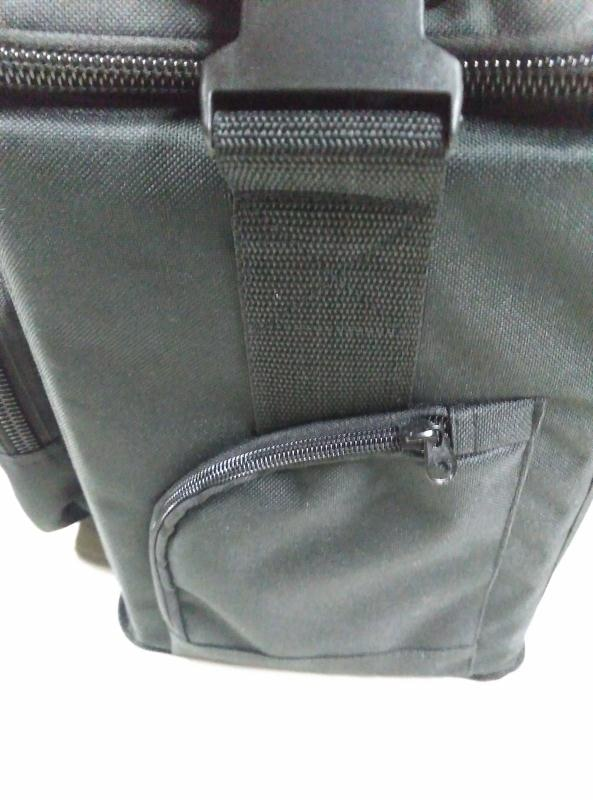 The side pockets can hold keys, a wallet, or other small items.