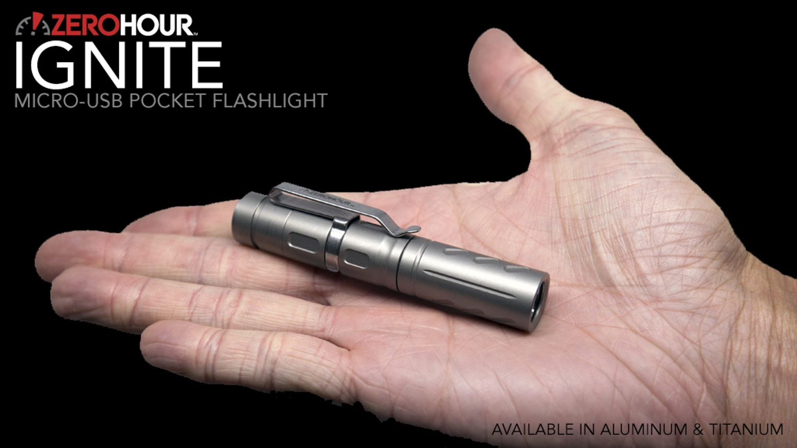 Ultra-compact everyday carry flashlight with rechargeable micro-USB port. Matte black aluminum, matte titanium, or polished titanium.