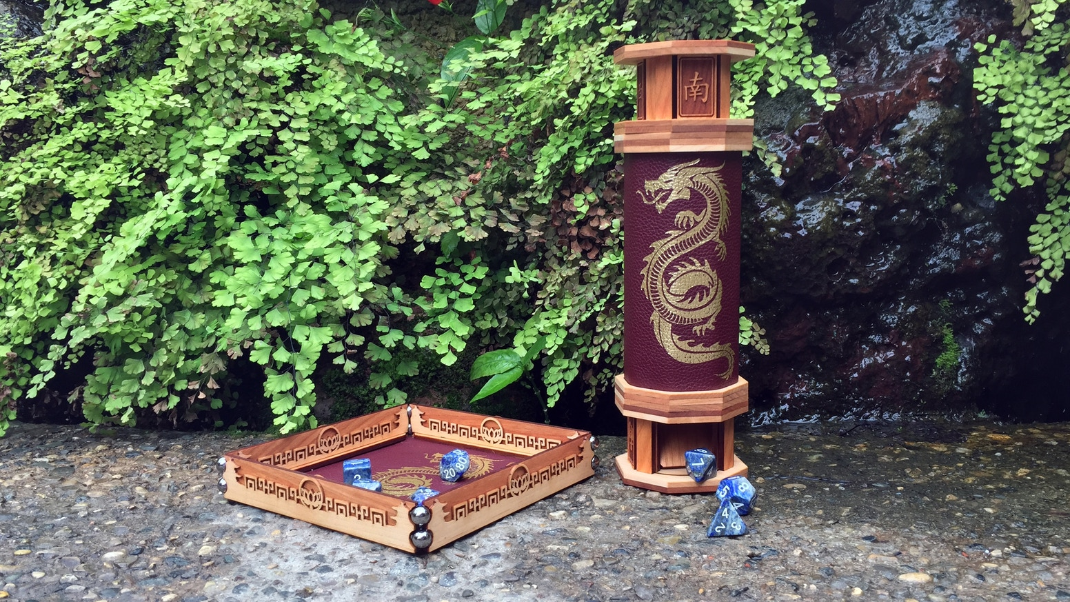 A bespoke, leather-bound scroll case that transforms into a dice tower with a scroll that unrolls into a rolling tray