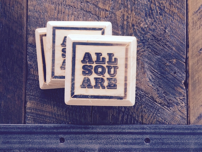 All Square wooden hand-branded coasters