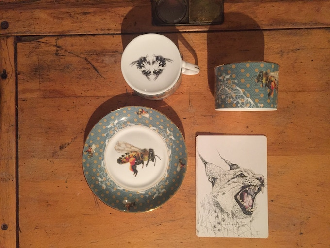 Gold rimmed save the bee cup and saucer with postcard