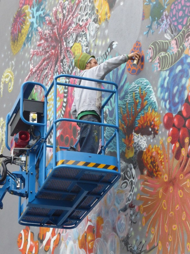 LOUIS MASAI PAINTING CORALS FOR SYNCHRONICITY EARTH