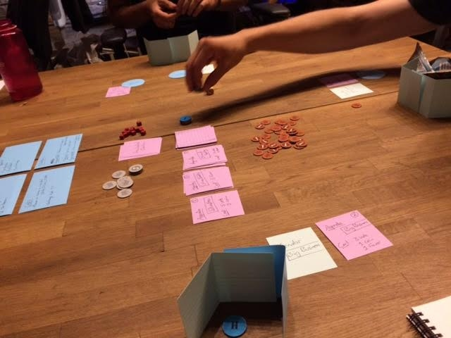 Mysterious hands playtesting an early prototype