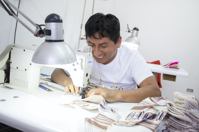 Joel sews the outsole for a prototype design.